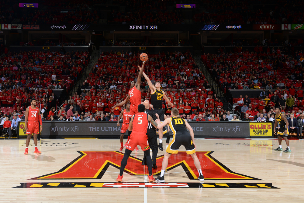 Iowa Hawkeyes center Luka Garza (55) battles for the opening tipoff during their game at the Xfinity Center in College Park, MD on Thursday, January 30, 2020. (University of Maryland Athletics)
