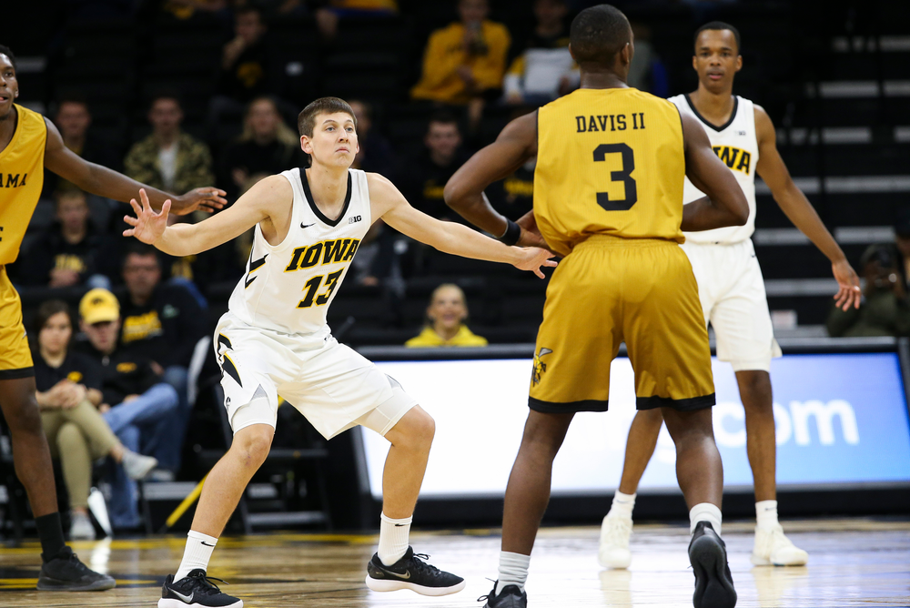 Iowa Hawkeyes guard Austin Ash (13) defends during a game against Alabama State at Carver-Hawkeye Arena on November 21, 2018. (Tork Mason/hawkeyesports.com)