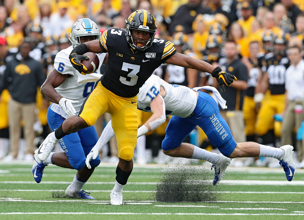 Iowa Hawkeyes wide receiver Tyrone Tracy Jr. (3) spins away from a defender after pulling in a pass during third quarter of their game at Kinnick Stadium in Iowa City on Saturday, Sep 28, 2019. (Stephen Mally/hawkeyesports.com)