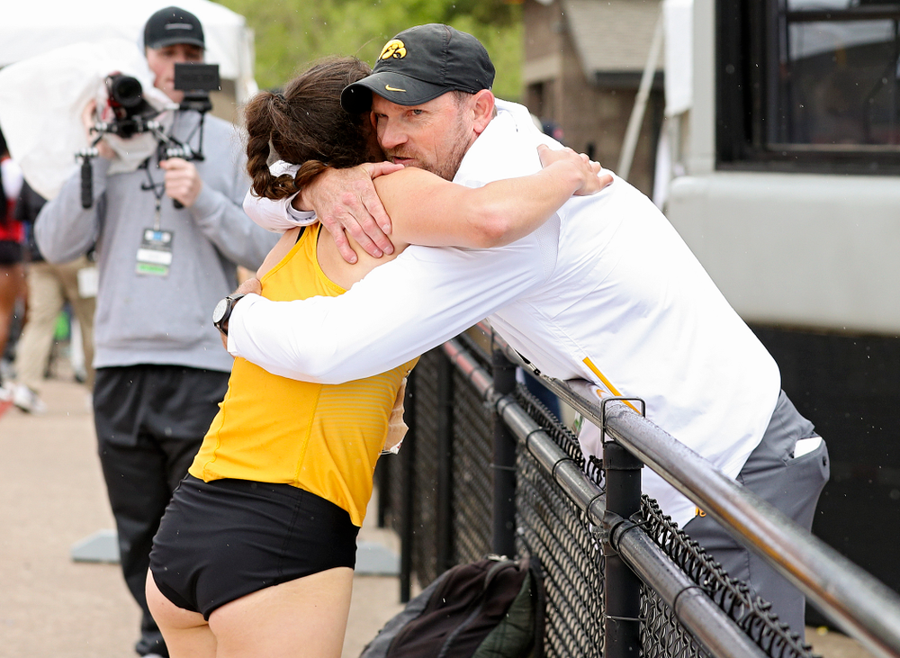 Iowa's Jenny Kimbro (from left) gets a hug from Director of Track and Field Joey Woody after Kimbro ran the women's 400 meter hurdles event on the third day of the Big Ten Outdoor Track and Field Championships at Francis X. Cretzmeyer Track in Iowa City on Sunday, May. 12, 2019. (Stephen Mally/hawkeyesports.com)