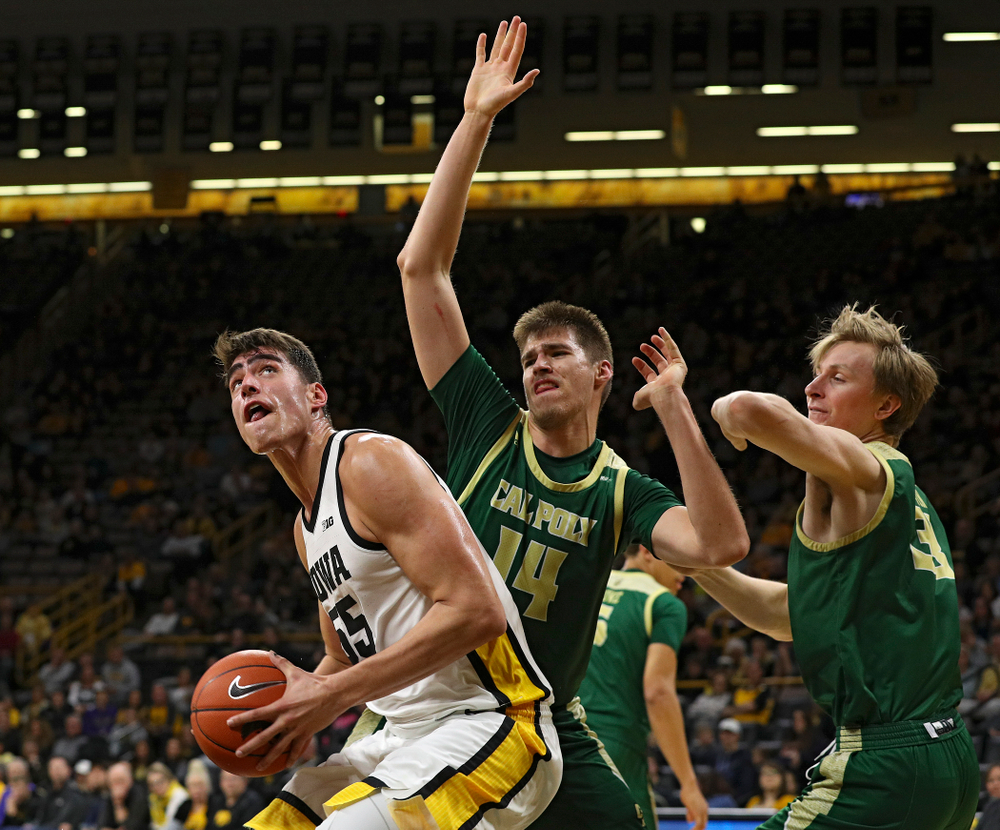 Iowa Hawkeyes center Luka Garza (55) eyes the basket during the first half of their game at Carver-Hawkeye Arena in Iowa City on Sunday, Nov 24, 2019. (Stephen Mally/hawkeyesports.com)