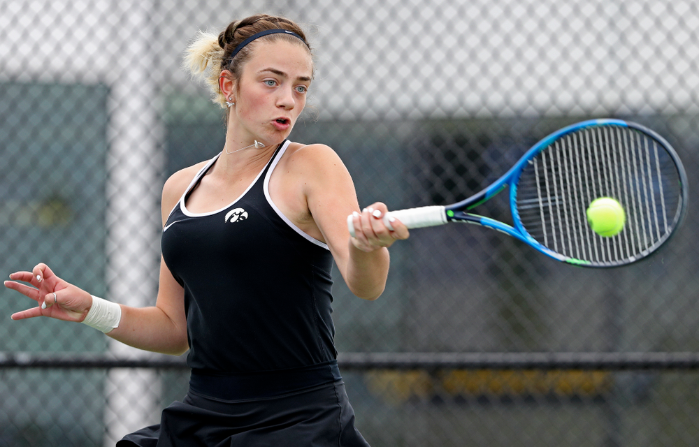 Iowa's Sophie Clark returns a shot during their doubles match against Rutgers at the Hawkeye Tennis and Recreation Complex in Iowa City on Friday, Apr. 5, 2019. (Stephen Mally/hawkeyesports.com)