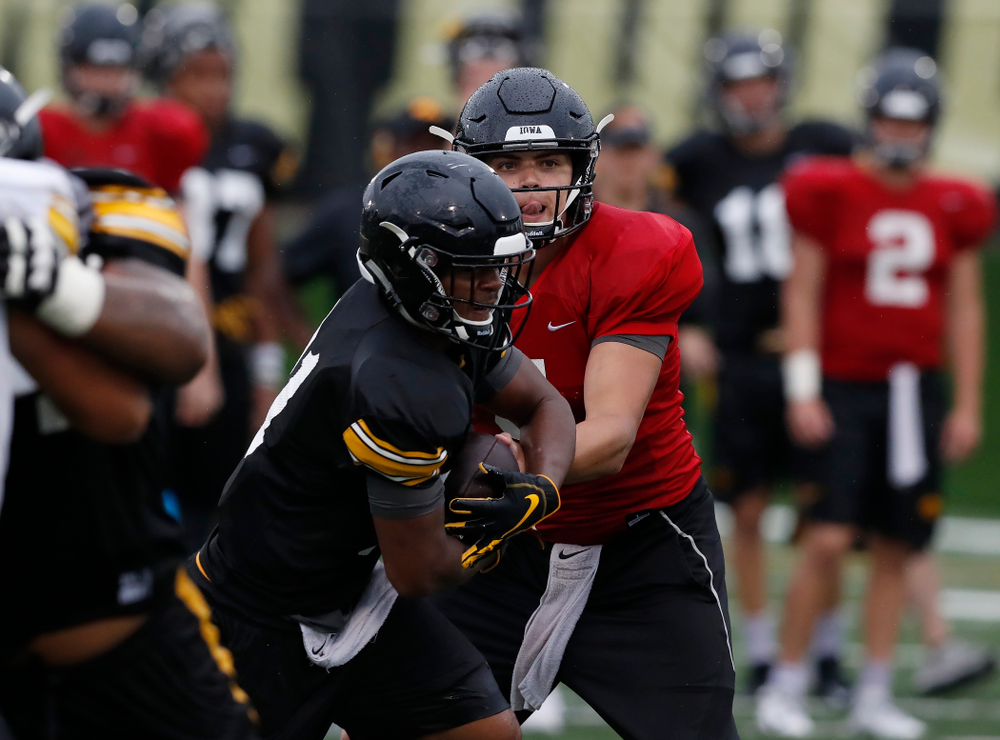quarterback Nathan Stanley (4) and defensive back Josh Turner (4) during camp practice No. 15  Monday, August 20, 2018 at the Hansen Football Performance Center. (Brian Ray/hawkeyesports.com)