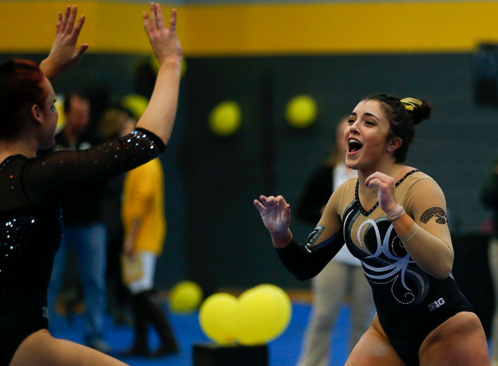 Nikki Youd celebrates after her balance beam routine during the Black and Gold Intrasquad meet at the Field House on 12/2/17. (Tork Mason/hawkeyesports.com)