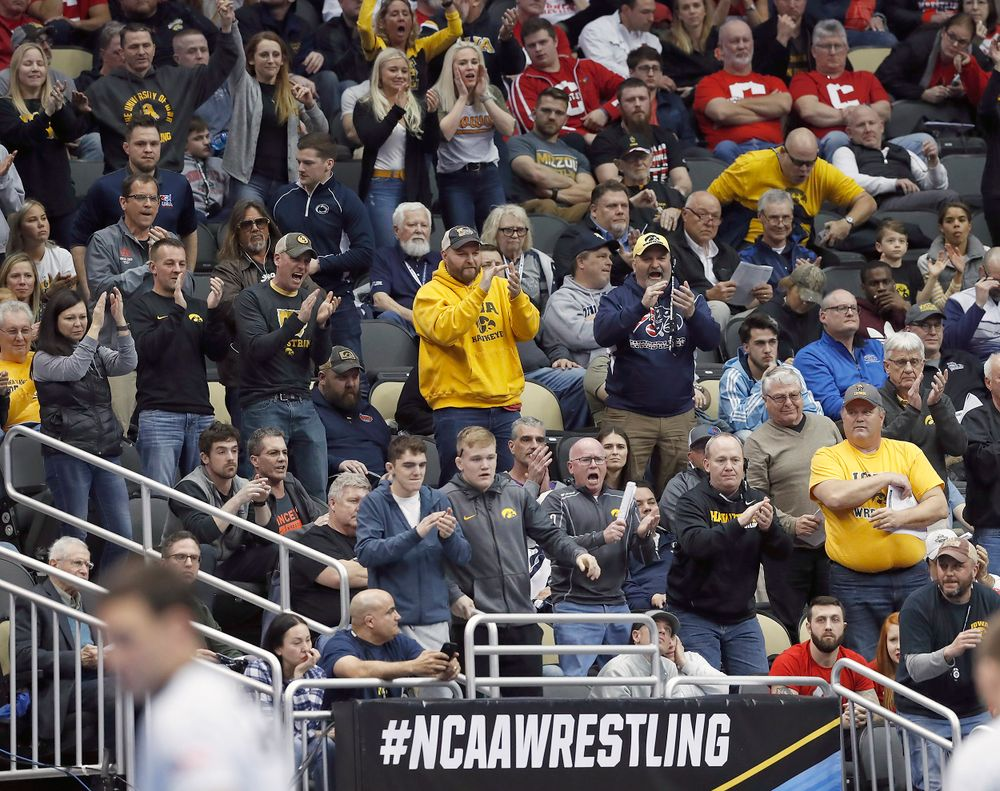 Hawkeye fans celebrate a win by Max Murin