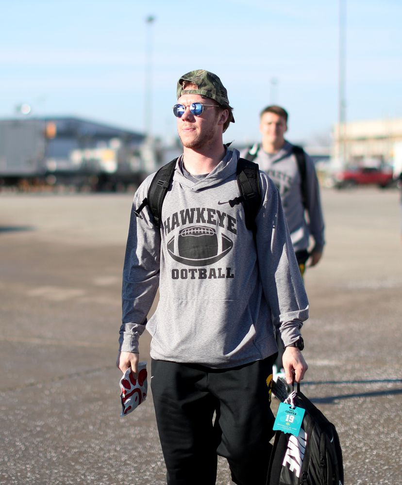 Iowa Hawkeyes wide receiver Max Cooper (19) boards the team plane at the Eastern Iowa Airport Saturday, December 21, 2019 on the way to San Diego, CA for the Holiday Bowl. (Brian Ray/hawkeyesports.com)