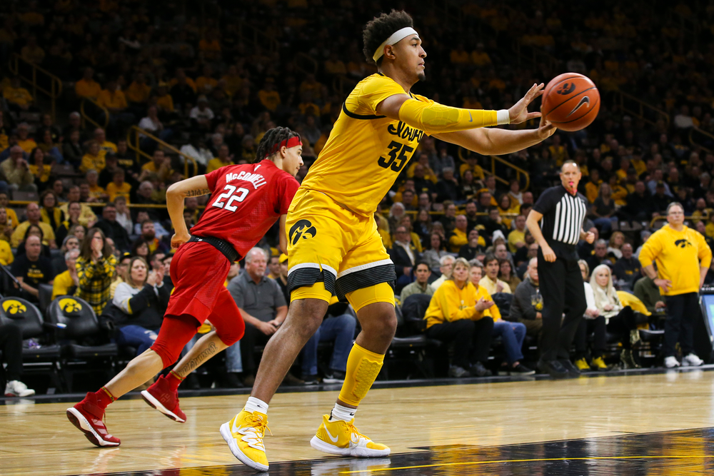 Iowa Hawkeyes forward Cordell Pemsl (35) passes the ball during the Iowa men's basketball game vs Rutgers on Wednesday, January 22, 2020 at Carver-Hawkeye Arena. (Lily Smith/hawkeyesports.com)