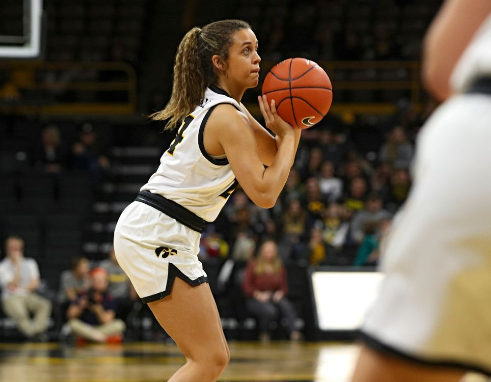 Iowa Hawkeyes guard Gabbie Marshall (24) lines up a 3-pointer during the third quarter of their game at Carver-Hawkeye Arena in Iowa City on Tuesday, December 31, 2019. (Stephen Mally/hawkeyesports.com)