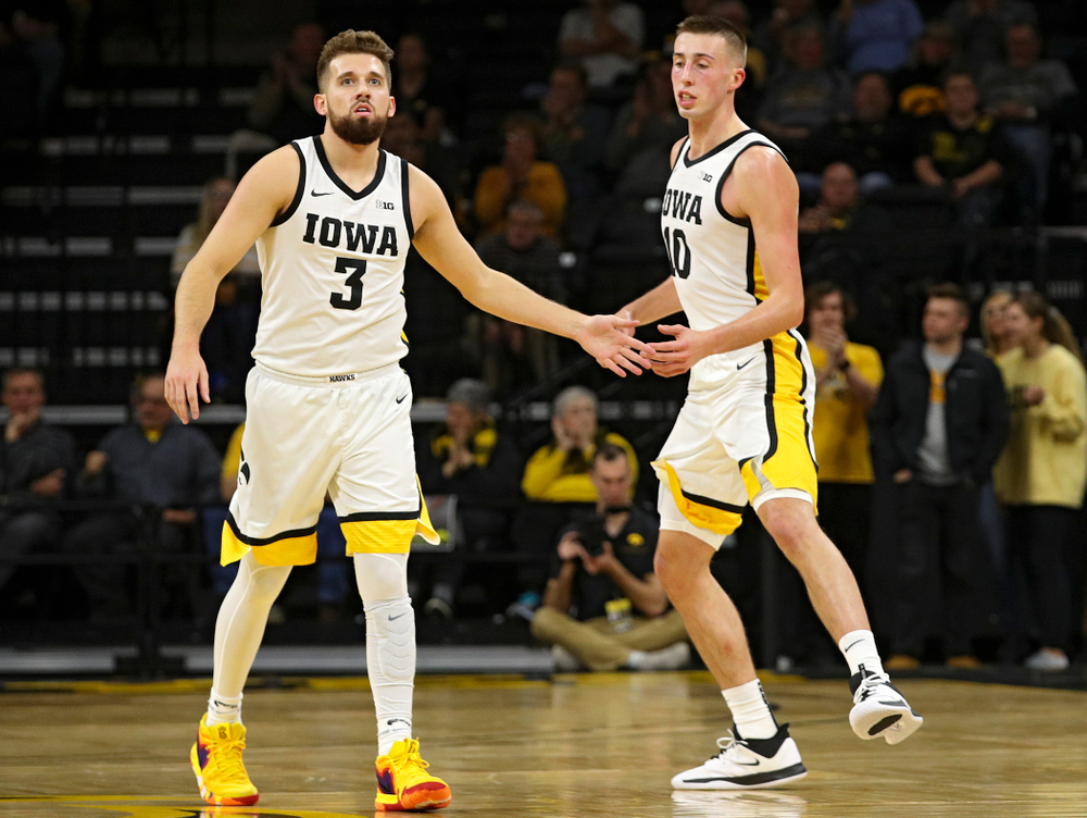 Iowa Hawkeyes guard Jordan Bohannon (3) slaps hands with guard Joe Wieskamp (10) as they run back on defense after a score during the first half of their game at Carver-Hawkeye Arena in Iowa City on Friday, Nov 8, 2019. (Stephen Mally/hawkeyesports.com)