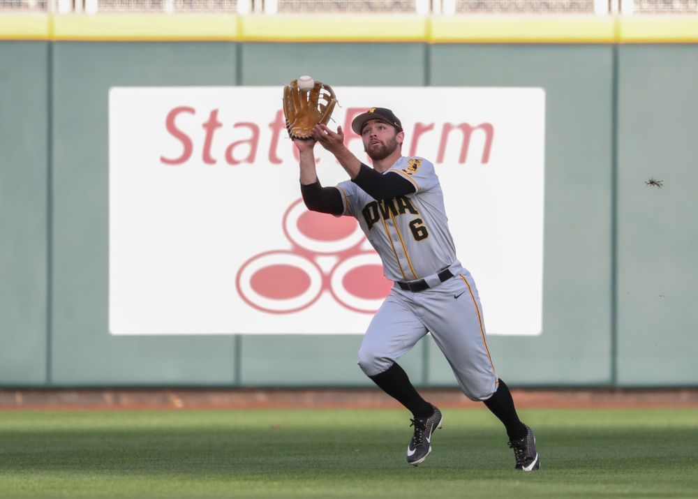 Iowa Hawkeyes outfielder Justin Jenkins (6) catches a fly ball against the Indiana Hoosiers in the first round of the Big Ten Baseball Tournament Wednesday, May 22, 2019 at TD Ameritrade Park in Omaha, Neb. (Brian Ray/hawkeyesports.com)