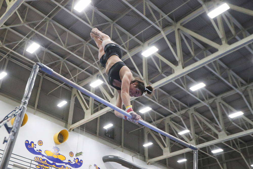 Ashley Smith performs on the uneven bars during the Iowa women's gymnastics Black and Gold Intraquad Meet on Saturday, December 7, 2019 at the UI Field House. (Lily Smith/hawkeyesports.com)