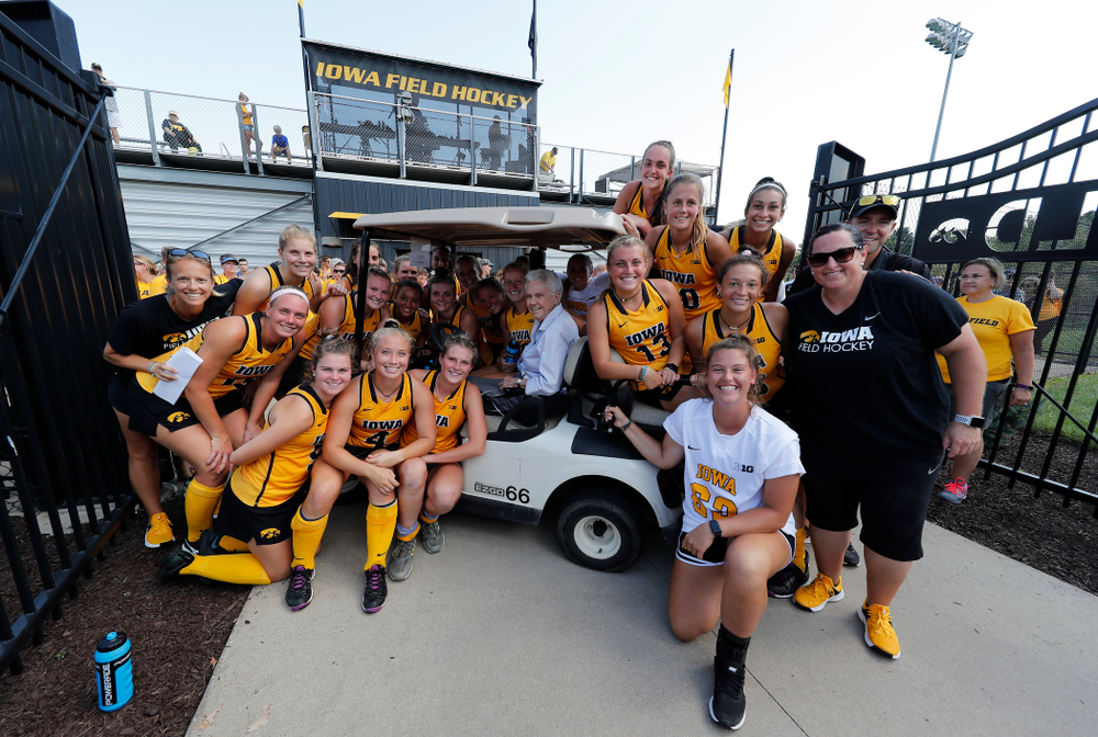 Members of the current Iowa Field Hockey Team pose for a photo with Dr. Christine Grant following the Iowa Hawkeyes victory over Indiana Sunday, September 16, 2018 at Grant Field. (Brian Ray/hawkeyesports.com)