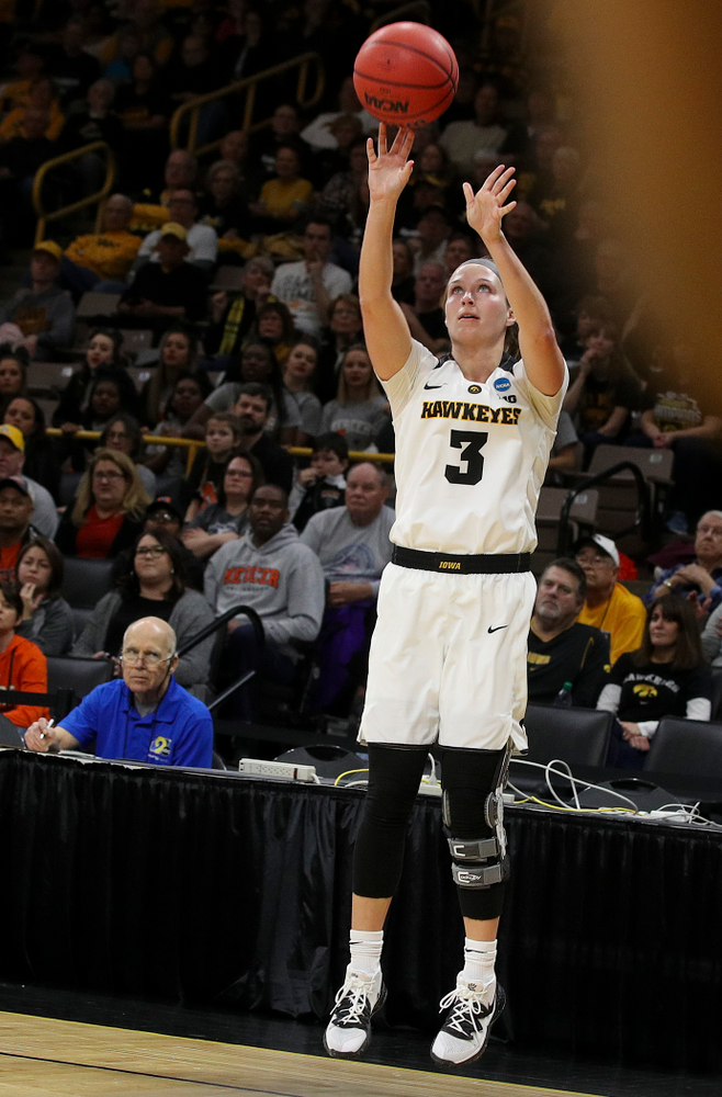 Iowa Hawkeyes guard Makenzie Meyer (3) makes a 3-pointer just before halftime during the first round of the 2019 NCAA Women's Basketball Tournament at Carver Hawkeye Arena in Iowa City on Friday, Mar. 22, 2019. (Stephen Mally for hawkeyesports.com)