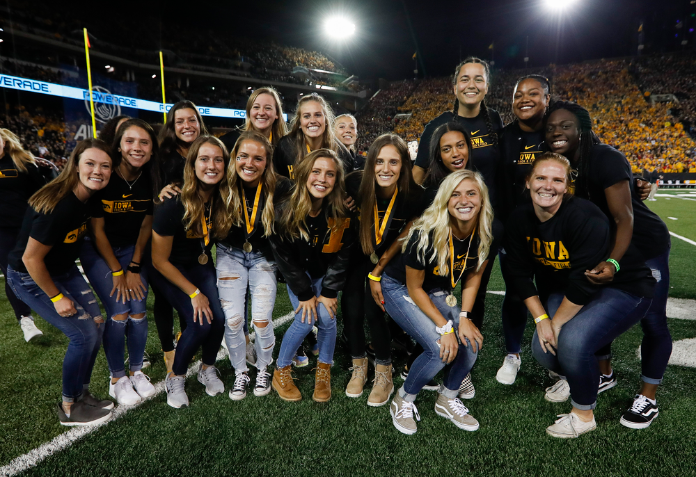 Members of the Iowa women's track and field team are recognized by the Presidential Committee on Athletics at halftime during a game against Wisconsin on September 22, 2018. (Tork Mason/hawkeyesports.com)