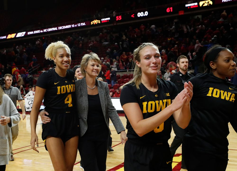 Iowa Hawkeyes forward Chase Coley (4) and head coach Lisa Bluder