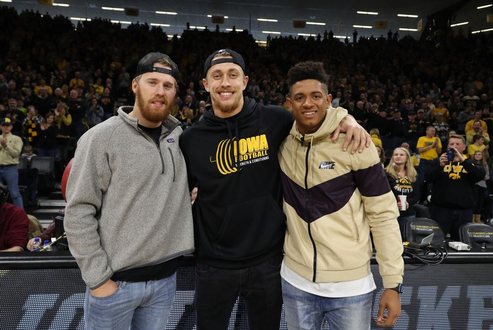 Former Hawkeye Football players and current San Francisco 49ers George Kittle, Greg Mabin, and CJ Beathard, against the Ohio State Buckeyes Saturday, January 12, 2019 at Carver-Hawkeye Arena. (Brian Ray/hawkeyesports.com)