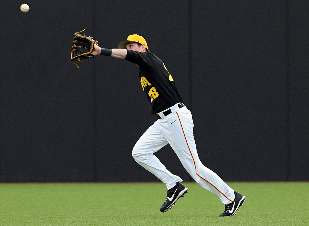 Iowa Hawkeyes left fielder Chris Whelan (28) makes a running catch for an out during the third inning of their game against Western Illinois at Duane Banks Field in Iowa City on Wednesday, May. 1, 2019. (Stephen Mally/hawkeyesports.com)