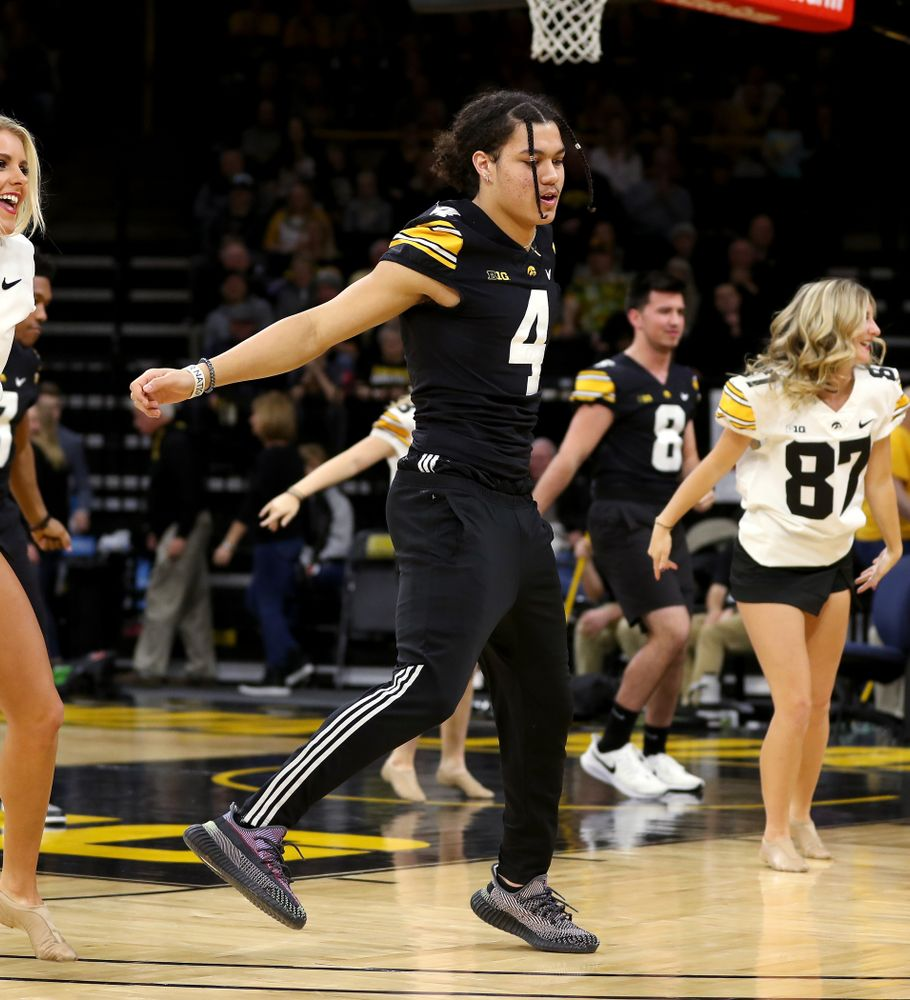 Members of the Hawkeye Football team performs with the Iowa Dance Team at halftime of the Iowa Hawkeyes game against the Ohio State Buckeyes Thursday, February 20, 2020 at Carver-Hawkeye Arena. (Brian Ray/hawkeyesports.com)