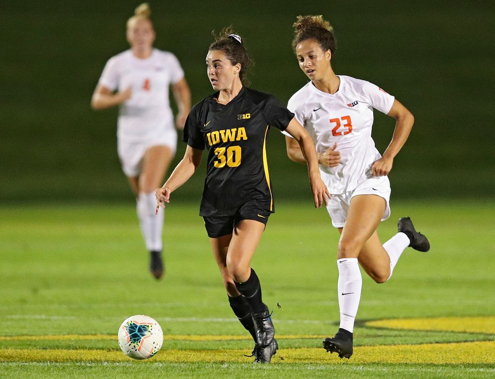 Iowa forward Devin Burns (30) looks down field as she moves with the ball during the first half of their match against Illinois at the Iowa Soccer Complex in Iowa City on Thursday, Sep 26, 2019. (Stephen Mally/hawkeyesports.com)