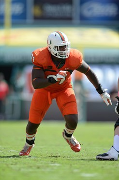 University of Miami Hurricanes defensive lineman Olsen Pierre #91 plays in a game against the Wake Forest Demon Deacons at Sun Life Stadium on October...