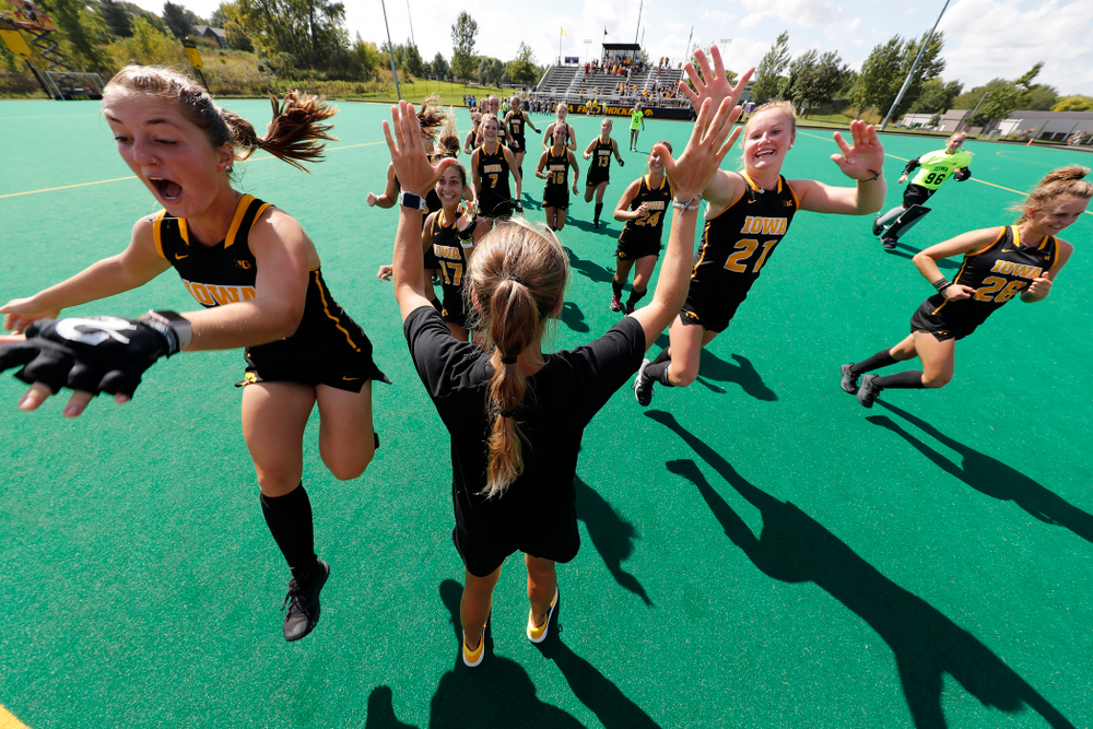 Iowa Hawkeyes Isabella Solaroli (16) and Makenna Maguire (21) high five assistant coach Roz Ellis before their game against the Penn Quakers Friday, September 14, 2018 at Grant Field. (Brian Ray/hawkeyesports.com)