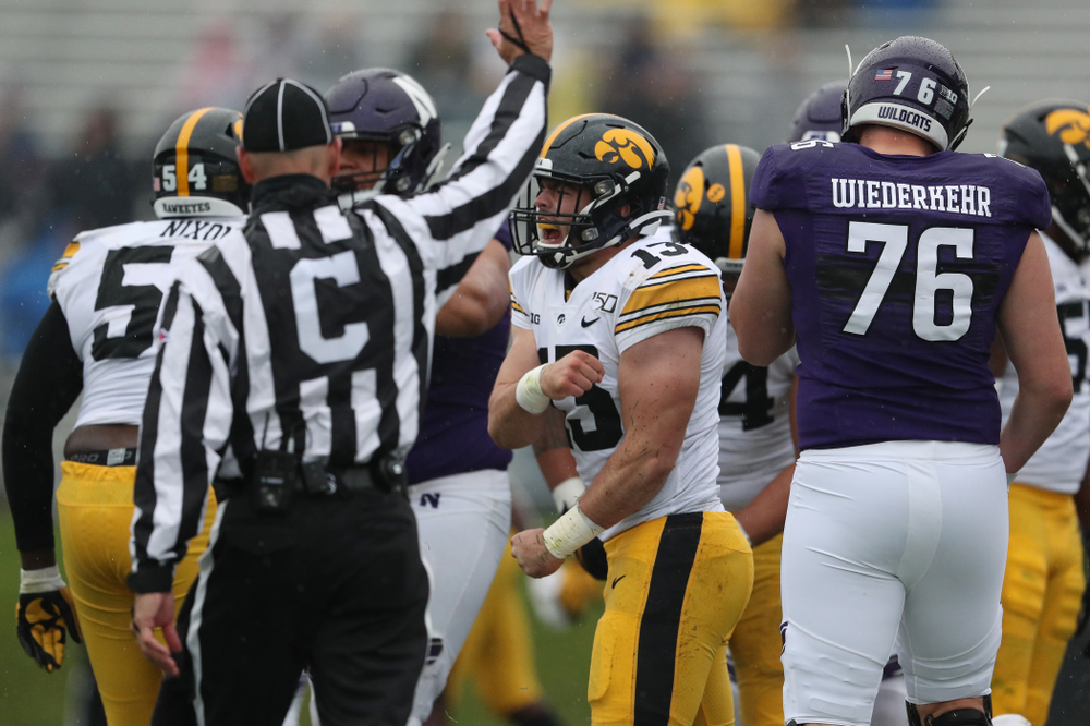 Iowa Hawkeyes linebacker Joe Evans (13) celebrates his first career sack against the Northwestern Wildcats Saturday, October 26, 2019 at Ryan Field in Evanston, Ill. (Brian Ray/hawkeyesports.com)