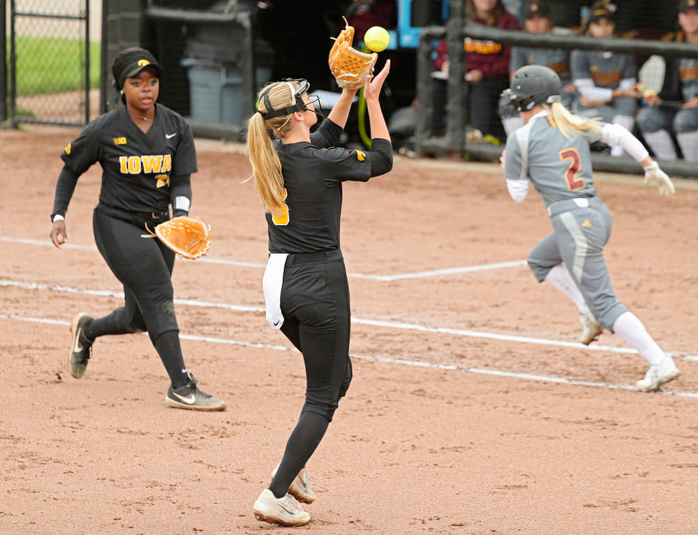 Iowa pitcher Allison Doocy (3) pulls in a pop up for an out as DoniRae Mayhew (24) looks on during the fourth inning of their game against Iowa Softball vs Indian Hills Community College at Pearl Field in Iowa City on Sunday, Oct 6, 2019. (Stephen Mally/hawkeyesports.com)
