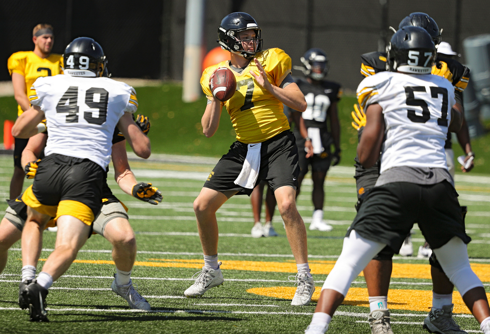 Iowa Hawkeyes quarterback Spencer Petras (7) drops back to pass during Fall Camp Practice No. 7 at the Hansen Football Performance Center in Iowa City on Friday, Aug 9, 2019. (Stephen Mally/hawkeyesports.com)