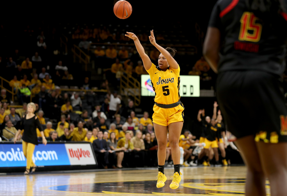 Iowa Hawkeyes guard Alexis Sevillian (5) knocks down a three point basket against the Maryland Terrapins Thursday, January 9, 2020 at Carver-Hawkeye Arena. (Brian Ray/hawkeyesports.com)