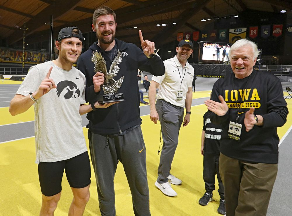 Larry Wieczorek (right) presents the men's team award to Iowa's Tysen VanDraska (left) and Nolan Teubel during the Larry Wieczorek Invitational at the Recreation Building in Iowa City on Saturday, January 18, 2020. (Stephen Mally/hawkeyesports.com)