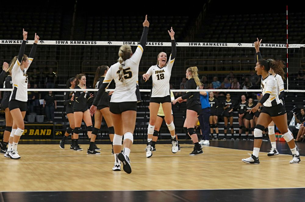 Iowa's Meghan Buzzerio (5), Maddie Slagle (15), Hannah Clayton (18), Brie Orr (7), and Courtney Buzzerio (2) celebrate a score during the first set of their Big Ten/Pac-12 Challenge match against Colorado at Carver-Hawkeye Arena in Iowa City on Friday, Sep 6, 2019. (Stephen Mally/hawkeyesports.com)