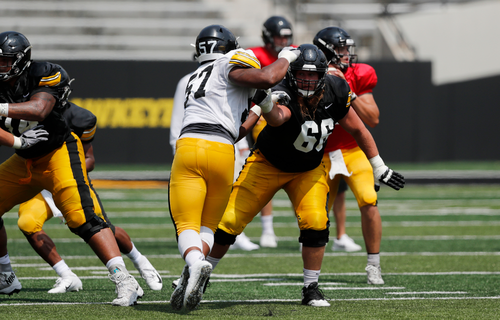 Iowa Hawkeyes offensive lineman Levi Paulsen (66) and defensive end Chauncey Golston (57) during Kids Day Saturday, August 11, 2018 at Kinnick Stadium. (Brian Ray/hawkeyesports.com)