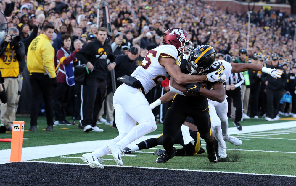 Iowa Hawkeyes running back Tyler Goodson (15) fights his way into the end zone for a touchdown against the Minnesota Golden Gophers Saturday, November 16, 2019 at Kinnick Stadium. (Brian Ray/hawkeyesports.com)