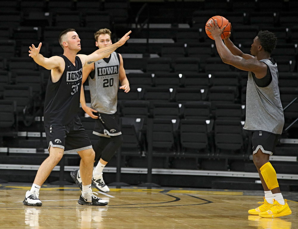 Iowa Hawkeyes guard Joe Toussaint (1) looks to pass around guard Connor McCaffery (30) during practice at Carver-Hawkeye Arena in Iowa City on Monday, Sep 30, 2019. (Stephen Mally/hawkeyesports.com)