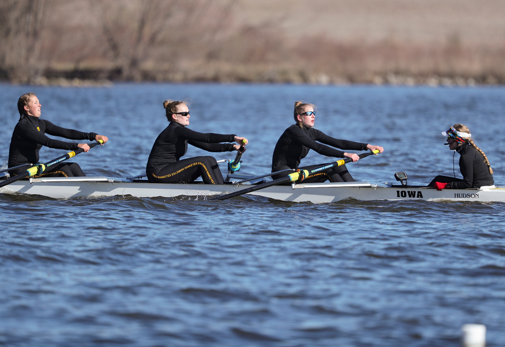 Iowa's Molly Rygh (from left), Kirsten Jurgersen, Amelia Juhl, and Alexis Wolf during their I Novice 8 race against Wisconsin in their Big Ten Double Dual Rowing Regatta at Lake Macbride in Solon on Saturday, Apr. 13, 2019. (Stephen Mally/hawkeyesports.com)