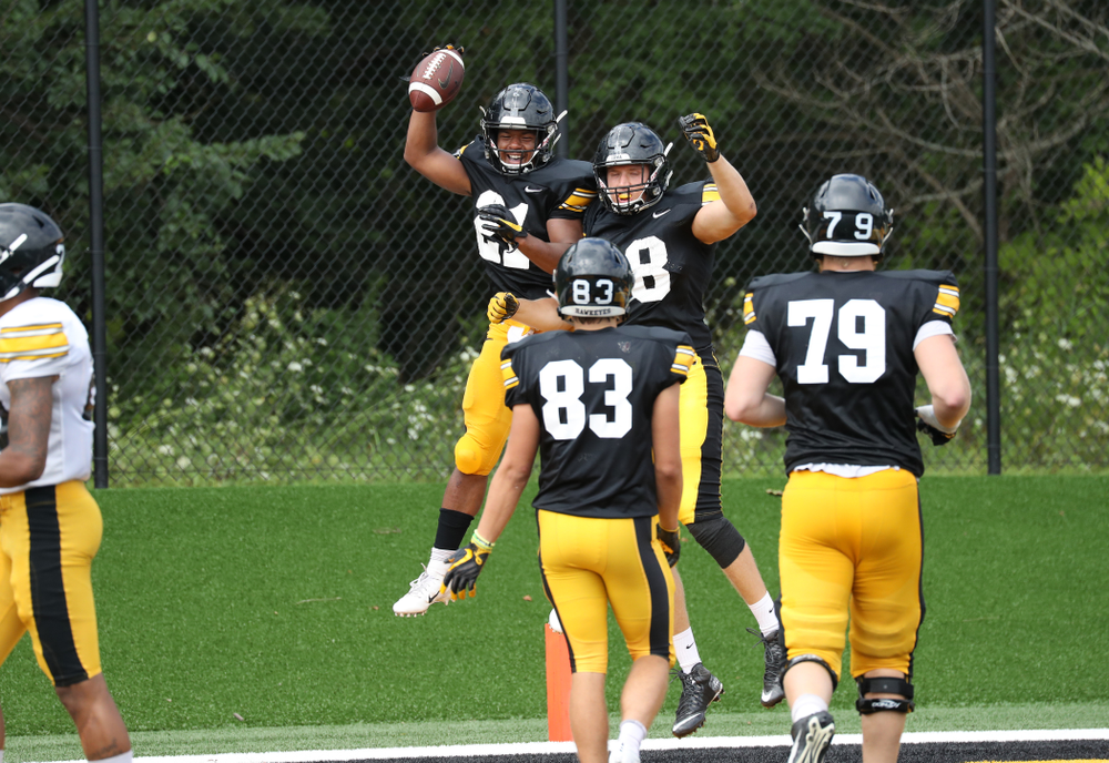 RB Ivory Kelly-Martin celebrates with his teammates after scoring a TD