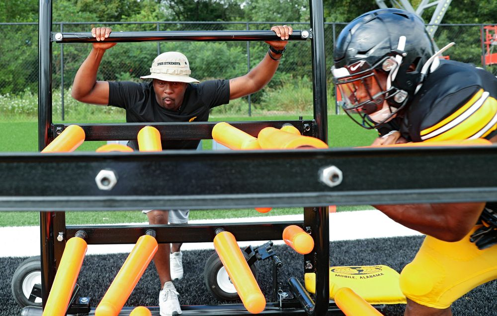 Iowa Hawkeyes running backs coach Derrick Foster looks on as running back Mekhi Sargent (10) runs a drill during Fall Camp Practice No. 11 at the Hansen Football Performance Center in Iowa City on Wednesday, Aug 14, 2019. (Stephen Mally/hawkeyesports.com)