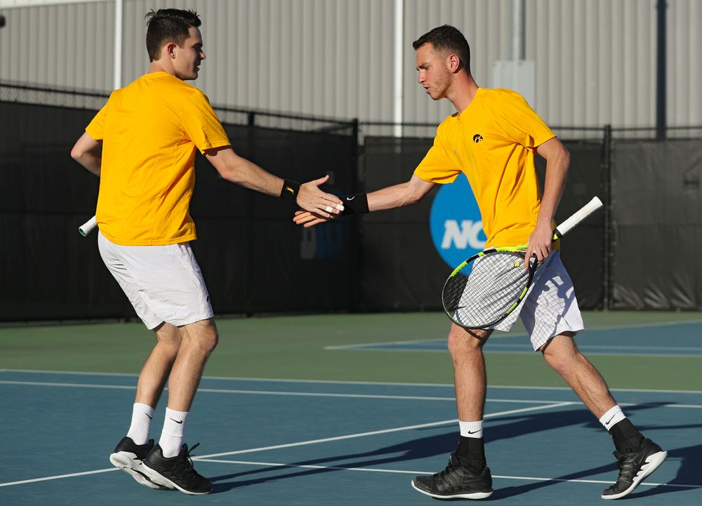 Iowa's Jonas Larsen (from left) and Kareem Allaf celebrate a point during their doubles match again Michigan State at the Hawkeye Tennis and Recreation Complex in Iowa City on Friday, Apr. 19, 2019. (Stephen Mally/hawkeyesports.com)