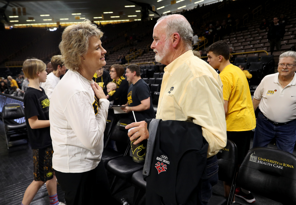Iowa Hawkeyes head coach Lisa Bluder and supporter Ted Pacha during a celebration of their Big Ten Women's Basketball Tournament championship Monday, March 18, 2019 at Carver-Hawkeye Arena. (Brian Ray/hawkeyesports.com)