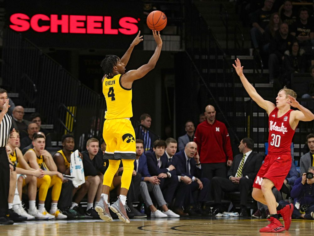 Iowa Hawkeyes guard Bakari Evelyn (4) makes a 3-pointer during the second half of their game at Carver-Hawkeye Arena in Iowa City on Saturday, February 8, 2020. (Stephen Mally/hawkeyesports.com)