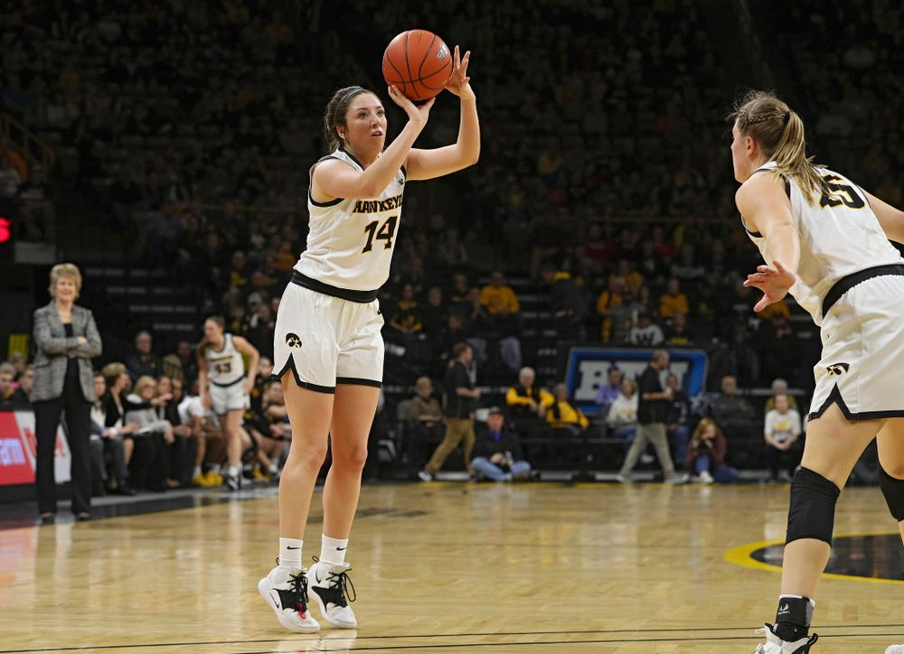 Iowa Hawkeyes guard Mckenna Warnock (14) makes a 3-pointer during the second quarter of their game at Carver-Hawkeye Arena in Iowa City on Sunday, January 26, 2020. (Stephen Mally/hawkeyesports.com)