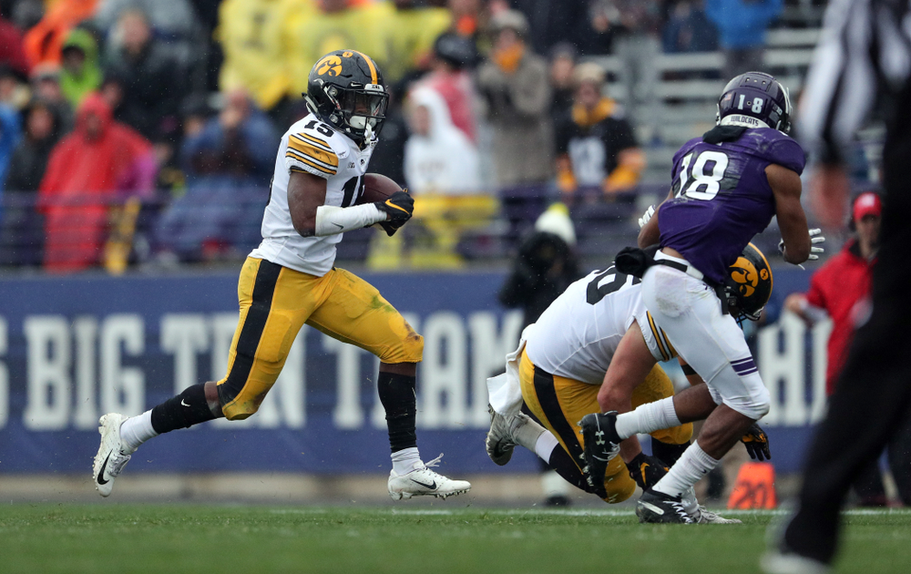 Iowa Hawkeyes running back Tyler Goodson (15) and fullback Brady Ross (36) against the Northwestern Wildcats Saturday, October 26, 2019 at Ryan Field in Evanston, Ill. (Brian Ray/hawkeyesports.com)