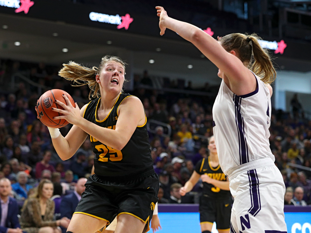 Iowa Hawkeyes forward Monika Czinano (25) looks to shoot during the second quarter of their game at Welsh-Ryan Arena in Evanston, Ill. on Sunday, January 5, 2020. (Stephen Mally/hawkeyesports.com)