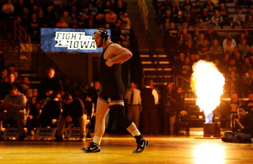 Iowa's Sam Stoll wrestles Oklahoma State's Derek White at heavyweight