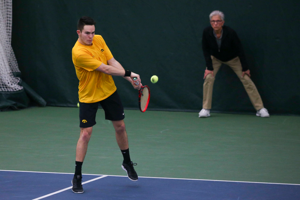 Jonas Larsen at a tennis match vs Drake  Friday, March 8, 2019 at the Hawkeye Tennis and Recreation Complex. (Lily Smith/hawkeyesports.com)