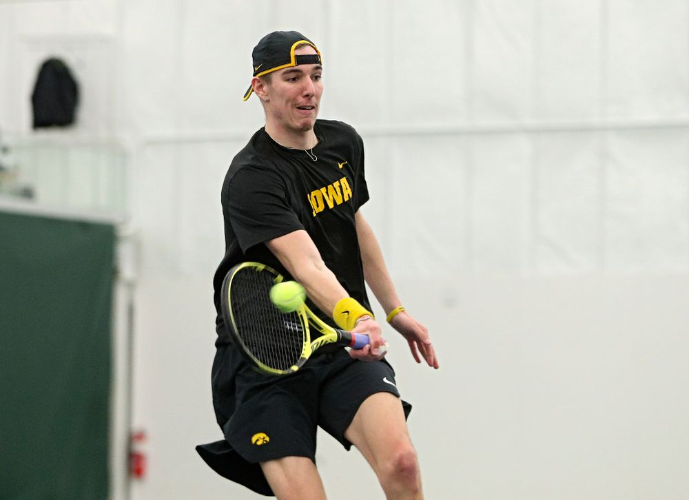 Iowa's Nikita Snezhko returns a shot during his singles match at the Hawkeye Tennis and Recreation Complex in Iowa City on Friday, March 6, 2020. (Stephen Mally/hawkeyesports.com)