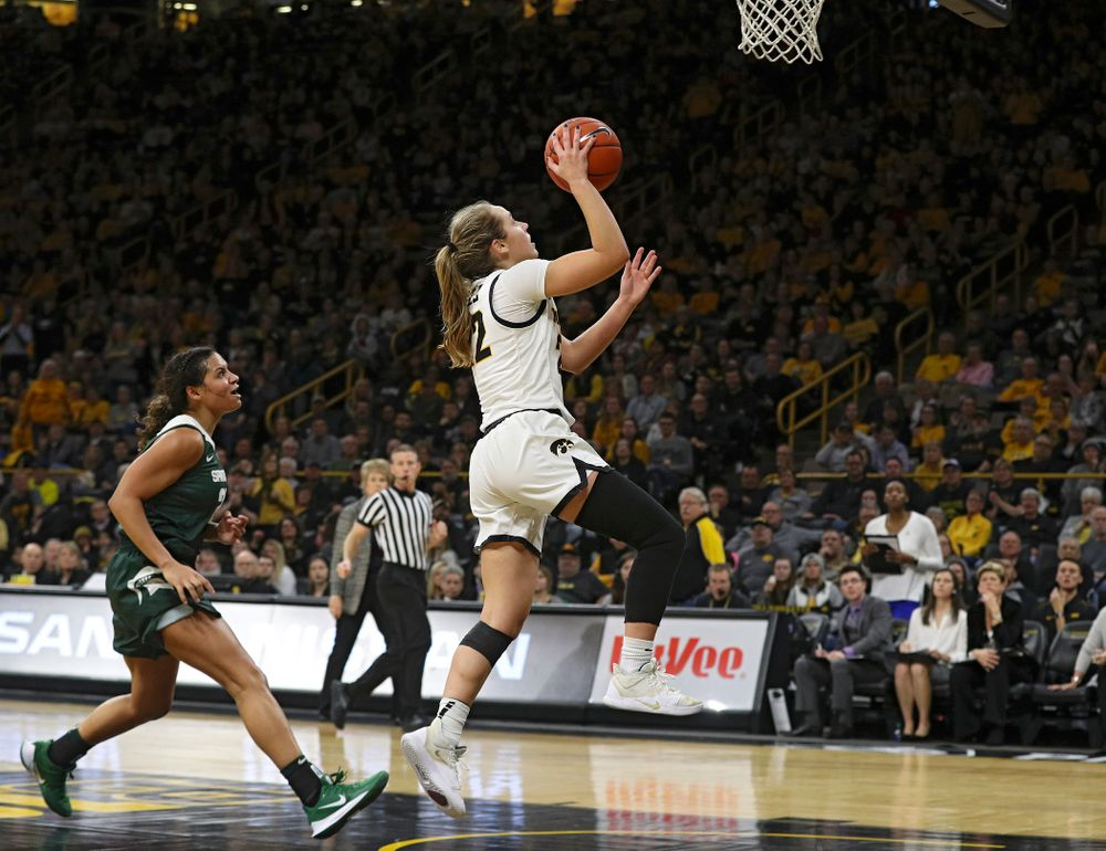 Iowa Hawkeyes guard Kathleen Doyle (22) makes a basket during the fourth quarter of their game at Carver-Hawkeye Arena in Iowa City on Sunday, January 26, 2020. (Stephen Mally/hawkeyesports.com)