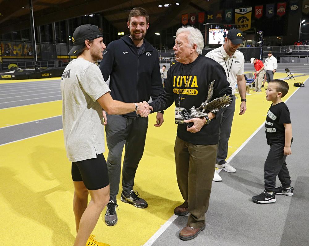 Larry Wieczorek (right) presents the men's team award to Iowa's Tysen VanDraska (left) and Nolan Teubel during the Larry Wieczorek Invitational at the Recreation Building in Iowa City on Saturday, January 18, 2020. (Stephen Mally/hawkeyesports.com)