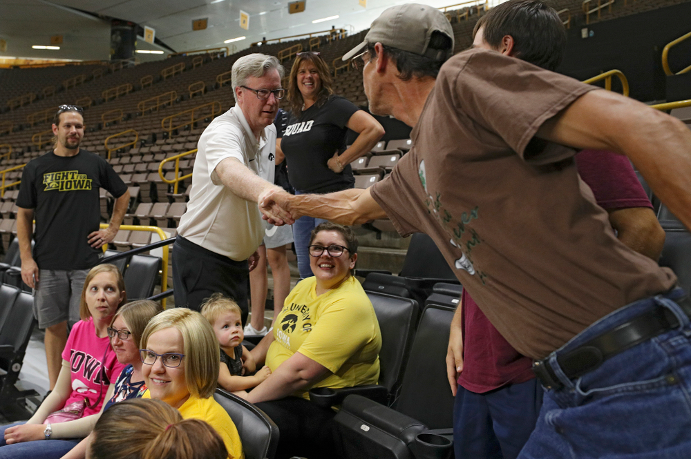 Iowa Hawkeyes head coach Fran McCaffery meets visitors from the University of Iowa Hospitals and Clinics Adolescent and Young Adult (AYA) Cancer Program during practice at Carver-Hawkeye Arena in Iowa City on Monday, Sep 30, 2019. (Stephen Mally/hawkeyesports.com)