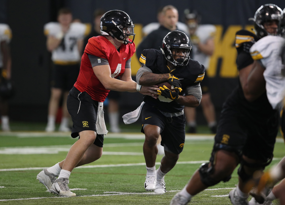 Iowa Hawkeyes quarterback Nate Stanley (4) and running back Mekhi Sargent (10) during preparation for the 2019 Outback Bowl Monday, December 17, 2018 at the Hansen Football Performance Center. (Brian Ray/hawkeyesports.com)